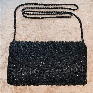 Elegant black beaded and sequined evening bag.